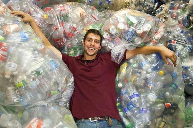 Zach Romano relaxing in a pile of recyclables
